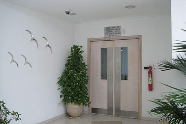 Toumazi Physio Gallery - Building inner door