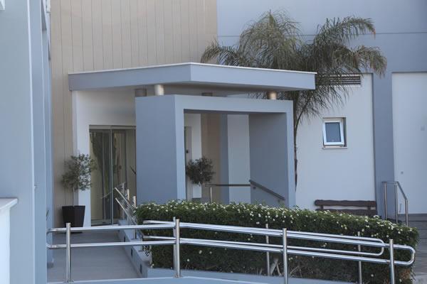 Toumazi Physio Gallery - Toumazis building door